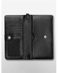 Calvin Klein - Black White Label Valerie Large Tech Wrist Wallet - Lyst