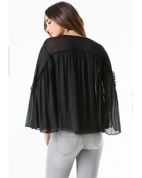 Bebe | Black Cape Sleeve Blouse | Lyst