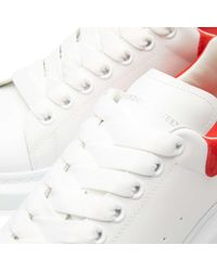 Alexander McQueen - Red Wedge Sole Suede Heel Tab Sneaker - Lyst