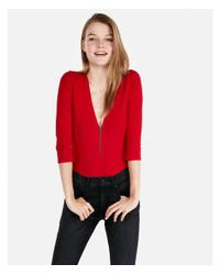Express - Red Petite One Eleven Deep V Front Zip Thong Bodysuit - Lyst