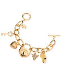 Guess | Metallic Gold-tone Charm Bracelet | Lyst