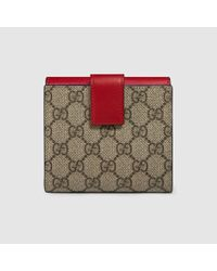 4d19b559b49 Lyst - Gucci Gg Supreme French Flap Wallet in Red