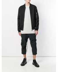The Viridi-anne Black Cropped Cargo Trousers for men