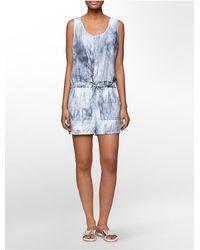 Calvin Klein - Blue Jeans Brushstroke Print Patch Front Sleeveless Romper - Lyst
