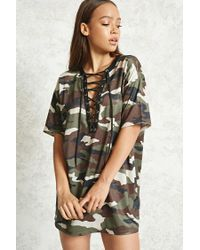 14359c0549 Lyst - Forever 21 Jersey Mesh Camo Dress in Brown