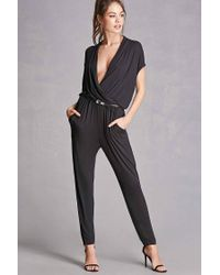 7d28725f50d Lyst - Forever 21 Plunging Surplice Jumpsuit in Black