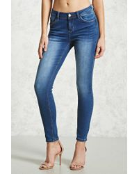 Forever 21 - Blue Mid-rise Skinny Jeans - Lyst