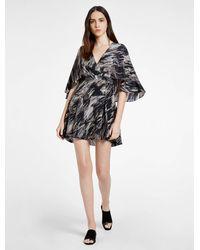 Halston | Black Flowy Silk Printed Mini Dress | Lyst