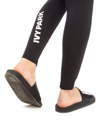Ivy Park - Black Logo Mid Rise Tights - Lyst