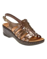 3d98bd2340fa10 Lyst - Clarks Lexi Marigold Strappy Sandals in Brown