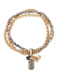 Kenneth Cole | Metallic Mixed Multi-charm Tri-tone Beaded Bracelet Set- Set Of 3 | Lyst