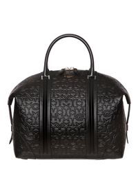 Givenchy | Black Star & Logo Embossed Leather Duffle Bag | Lyst