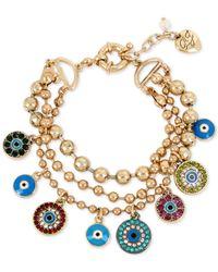 Betsey Johnson | Metallic Gold-tone Multi-charm Triple Row Bracelet | Lyst