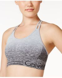 581d991394 Lyst - Calvin Klein Dip-dyed Strappy Low-support Sports Bra in Gray