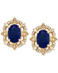 Macy's - Blue Sapphire (1-1/3 Ct. T.w.) & Diamond (1/8 Ct. T.w.) Stud Earrings In 14k Gold - Lyst