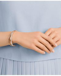 Swarovski - Metallic Rose Gold-tone Crisscross Crystal Cuff Bracelet - Lyst