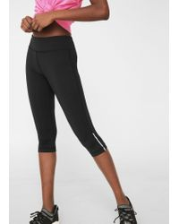 Mango | Black Slimming Effect Capri Leggings | Lyst