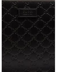 Gucci - Black Gg-debossed Leather Cross-body Bag for Men - Lyst