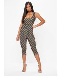 ceba9464cac1 Missguided Black Mg Scoop Back Unitard in Black - Lyst