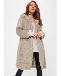 e534327d9f736 Lyst - Missguided Beige Collarless Shaggy Longline Coat in Natural