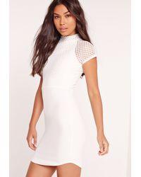 8dcdddb84ad Lyst - Missguided Fishnet Curved Hem Mini Dress White in White