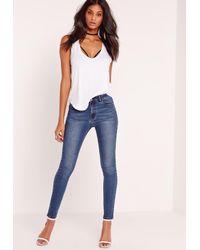 Missguided | Hustler Mid Rise Skinny Jeans Vintage Blue | Lyst