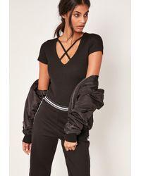 Missguided | Black Harness Neck Short Sleeve Bodysuit | Lyst