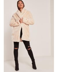 362d20e519ed8 Lyst - Missguided Pressed Faux Fur Coat Cream in Natural