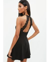 Missguided - Black Strappy Lace Back Skater Dress - Lyst