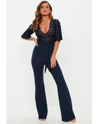 1dadd8a78e8 Missguided Navy Lace Plunge Kimono Sleeve Jumpsuit in Blue - Lyst
