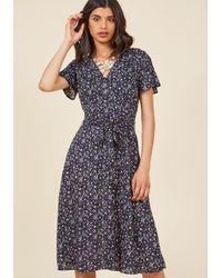 Sunny Girl Pty Lltd | Blue Flaunting Florals Surplice Midi Dress | Lyst