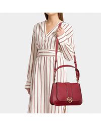 MICHAEL Michael Kors - Red Lillie Medium Top Handle Flap Bag In Black Calfskin - Lyst