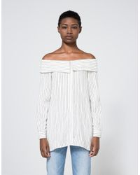8fbafa664aa615 Lyst - Tibi Frederic Striped Off Shoulder Top in Black