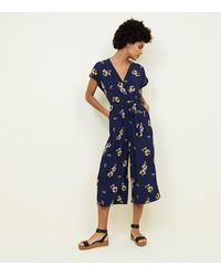 26207e950553 New Look Navy Floral Wrap Front Culotte Jumpsuit in Blue - Lyst