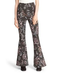 Free People - Black 'born To Be Wild' Print Flare Pants - Lyst