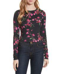 1c8220cc6cf556 Lyst - Alice + Olivia Delaina Long Sleeve Crewneck Crop Top in Black