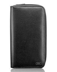 Tumi - Black Zip-around Leather Travel Wallet for Men - Lyst