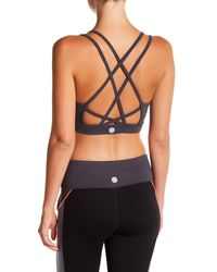1042c753bf Lyst - Threads For Thought Lotus Sports Bra