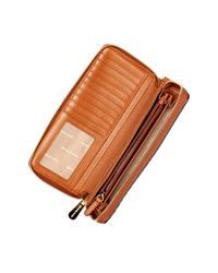 MICHAEL Michael Kors - Multicolor Leather Travel Continental Zip Around Wallet - Lyst