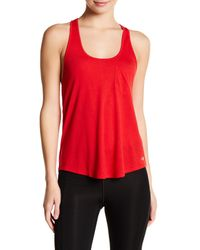 Alo Yoga | Red Extreme Racerback Tank | Lyst