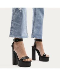 e7bc695078e4 Public Desire. Women s Valencia Metallic Platform Heels With Trim In Black