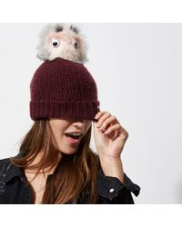 River Island - Dark Red Eyes Pom Pom Beanie Hat - Lyst