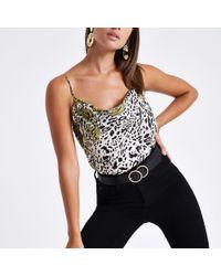 c80a4e57b79f4 Lyst - River Island Cream Leopard Print Cowl Neck Cami Top in Black