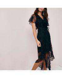 7ccbde4420 Lyst - River Island Black Lace Wrap Asymmetric Hem Midi Dress in Black
