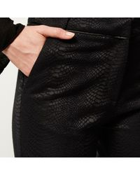 River Island - Black Snake Print Flare Trousers - Lyst