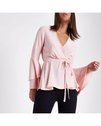 37d4ed9a7c636 Lyst - River Island Light Frill Sleeve Wrap Blouse in Pink