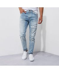 River Island - Mid Blue Fade Ripped Jimmy Slim Tapered Jeans for Men - Lyst