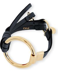 Chloé | Black Leather And Brass Circle Bracelet | Lyst