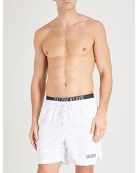b8e3cc6aa1 Calvin Klein Intense Power Double-waistband Swim Shorts in White for ...