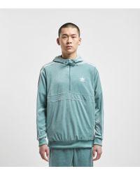 hot sale online aef17 26a6b adidas Originals. Men s Green Cozy 1 2 Zip Overhead Hoodie